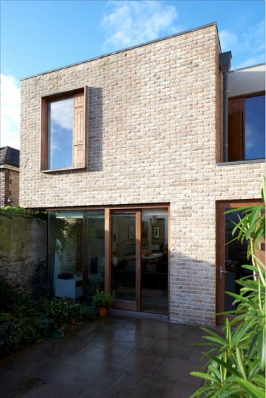 The brick was chosen to complement the old garden wall. Windows of different shapes and sizes were strategically positioned to ensure light fills the house throughout the day.