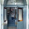 The floor tiles, which replicate the original, are from the Roscommon Tile Centre. The wallpaper is by Cole & Son.