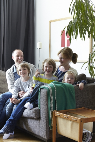 Russell Hart and Emer Fitzpatrick and their three children Eoghan, Alban and Fionn. The sofa is by Habitat, the curtains are from Ikea and the painting is by Willy McKeown from the Kerlin Gallery.