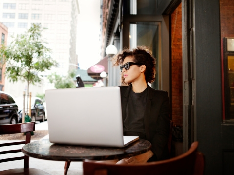 Woman in front of her laptop