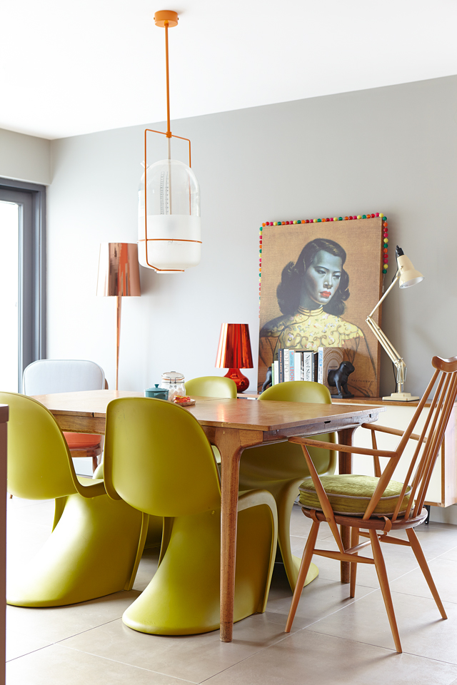 Patricia's parents bought the table second hand, when they lived in Manchester in the 1970s, and growing up, it was her family dining table. The Parlour light is by Donna Bates, from Maven. The standard lamp is an old purchase from Heal's. The Chartreuse chairs are by Panton. The chair at the end of the table is by Ercol. The orange and wood armchair (just seen) is from Twisted Vintage.