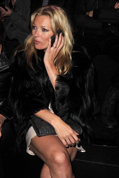 PARIS, FRANCE - JANUARY 24: Kate Moss attends the Etam Fashion Show Spring/Summer 2011 Collection Launch at Grand Palais on January 24, 2011 in Paris, France. (Photo by Pascal Le Segretain/Getty Images For Etam)