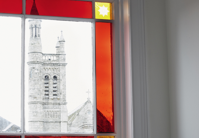 A stained glass window looking out on the gothic-looking Church of the Holy Name in Gavin Pendergast's Ranelagh home. From the Jan-Feb 2015 issue of Image Interiors & Living.