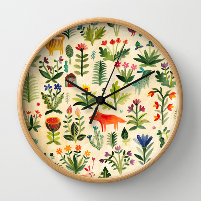 10 Cute and Colourful Clocks to Get You Through the Winter | Garden wall-clock by Society6