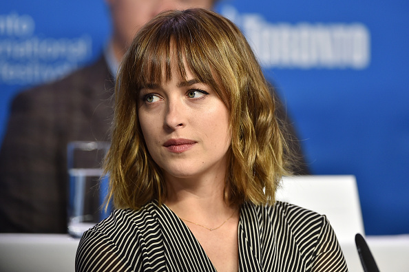 """TORONTO, ON - SEPTEMBER 14: Actress Dakota Johnson attends the """"Black Mass"""" press conference at the 2015 Toronto International Film Festival at TIFF Bell Lightbox on September 14, 2015 in Toronto, Canada. (Photo by Kevin Winter/Getty Images)"""