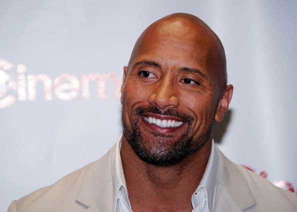 """LAS VEGAS, NV - APRIL 23:  Actor Dwayne Johnson, recipient of the Action Star of the Decade Award, arrives at a Paramount Pictures and DreamWorks Animation event at Caesars Palace during the opening night of CinemaCon, the official convention of the National Association of Theatre Owners, April 23, 2012 in Las Vegas, Nevada. Johnson is promoting his upcoming movie, """"G.I. Joe: Retaliation.""""  (Photo by Ethan Miller/Getty Images)"""