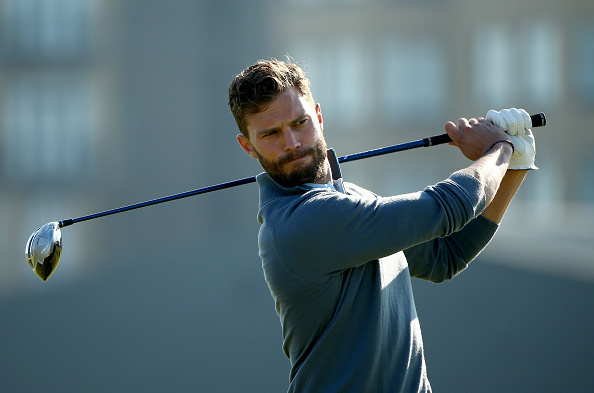 ST ANDREWS, SCOTLAND - SEPTEMBER 30: British actor Jamie Dornan plays off the third tee during the final practice round of the 2015 Alfred Dunhill Links Championship at The Old Course on September 30, 2015 in St Andrews, Scotland. (Photo by Ian Walton/Getty Images)